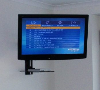 Tv Wall Mounted with a Single Shelf