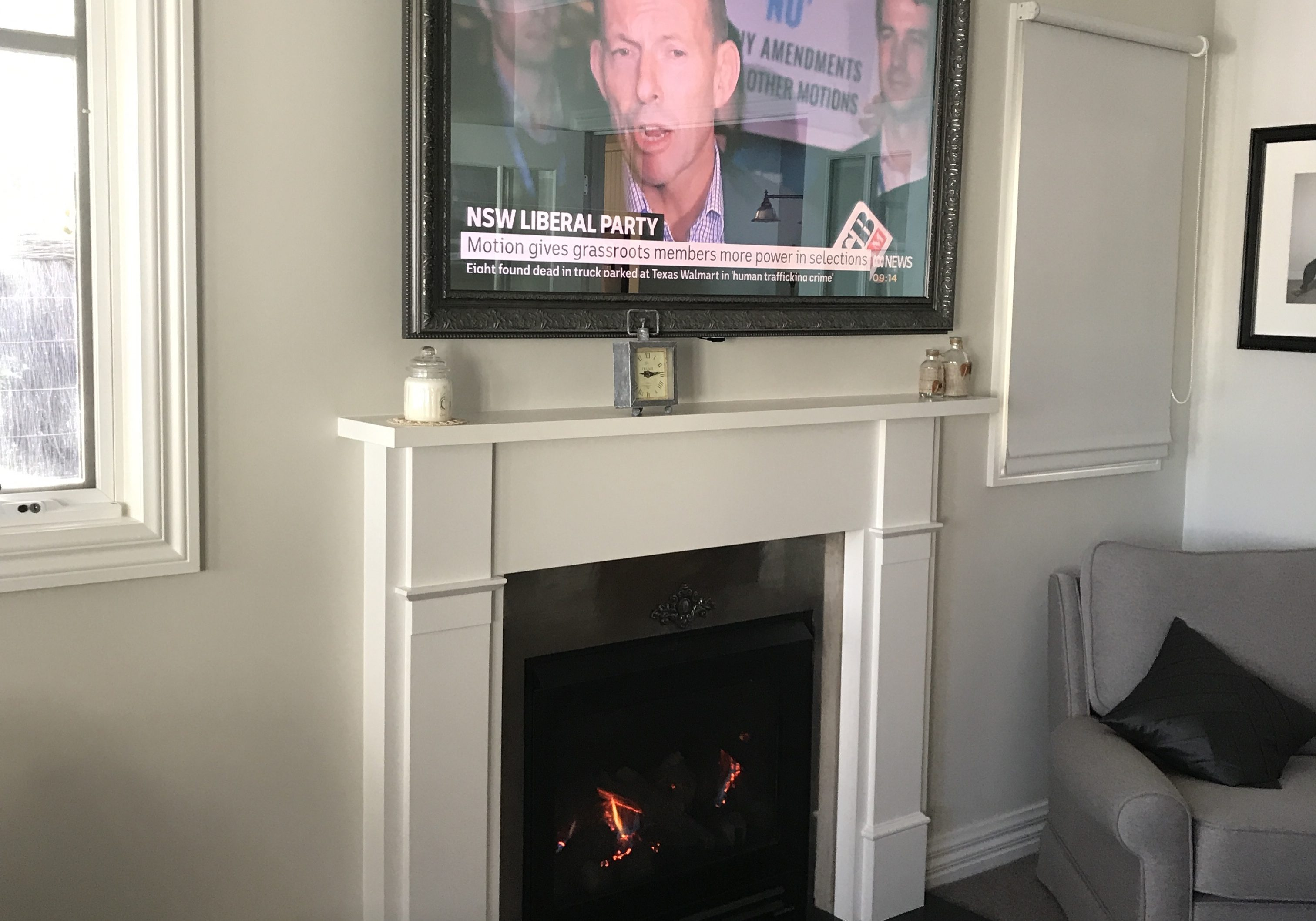 Tv Guy Hang my tv mirror frame attached with 2 way glass fire place